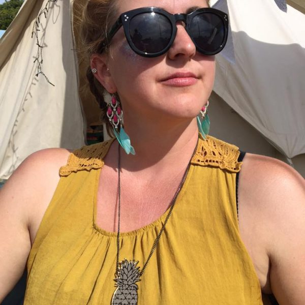 pineapple necklace being worn at a festival